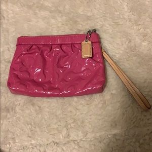 Coach pink wristlet. Patten leather. Great shape.